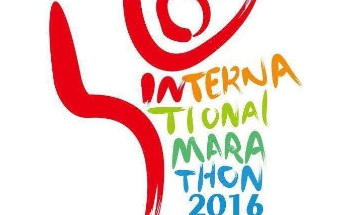 上合国际马拉松赛的标志和主题曲呼吁友好相处